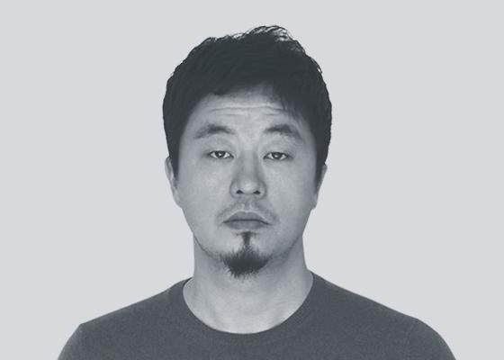 j-seungwooback headshoot.jpg